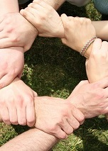 Eight friends have crossed hands